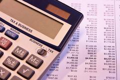 Time to calculate business tax. Business tax calculator and financial records Royalty Free Stock Photos
