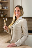 Time to celebrate: business woman with a glass of champagne Stock Photos