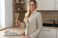 Time to celebrate: business woman with a glass of champagne Stock Images
