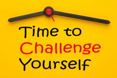 Time to Challenge Yourself. Written on yellow clock. Inspirational message stock photo