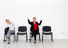 Time to change your attitude and change your life. Change your attitude and change your life concept with bored and excited woman on chairs Royalty Free Stock Photos
