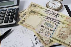 Time to check your expenses. Calculator with indian currency, bill and pen - time to check your expenditure concept