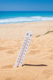 Time to come on vacation to the beach. Thermometer on the beach. Stock Photos