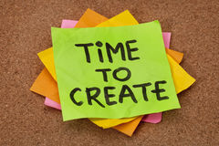 Time to create. Creativity concept - time to create reminder on a stack of sticky notes against cork bulletin board Royalty Free Stock Photos
