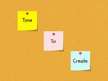 Time to Create Bulletin Board. The words Time to Create on colorful sticky notes on a cork bulletin board wth red push pins Stock Photo