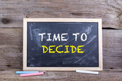 Time to Decide. Text on blackboard. Old wooden background royalty free stock image