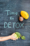 TIME TO DETOX chalk inscription on the wooden table fruits: mango, passion fruit and guava. Hand stretching to guava. Health Conce Royalty Free Stock Images