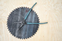 Time to do repairs. Conceptual image time to do repairs. Pliers as a clock hands and circular saw blade as a clock face with copy space for your text Stock Image