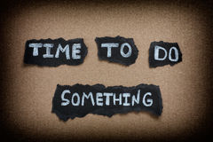 Time to do something. Brown paper background. Vignette stock photography
