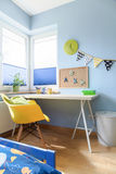 Time to do your homework. Shot of a desk in a colorful children's room Royalty Free Stock Images