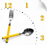 Time to eat. A clock with a fork and a spoon for hands Royalty Free Stock Photos