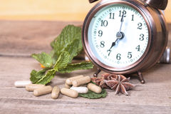 Time to eat Organic Herb capsule Royalty Free Stock Photo