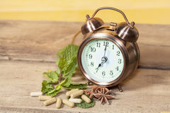 Time to eat Organic Herb capsule Stock Photography