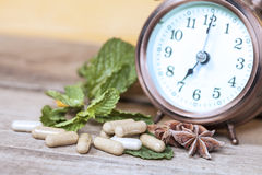 Time to eat Organic Herb capsule medicine Royalty Free Stock Images