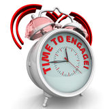 Time to engage! The alarm clock with an inscription Royalty Free Stock Images