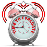 Time to evaluate. The alarm clock with an inscription Royalty Free Stock Photo