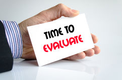 Time to evaluate text concept. Isolated over white background Royalty Free Stock Photo