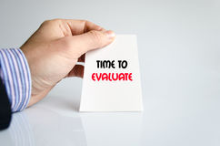 Time to evaluate text concept. Isolated over white background Royalty Free Stock Photography