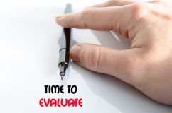 Time to evaluate text concept. Isolated over white background Royalty Free Stock Image