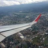 Time to explore the world, house and the city top view from the airplane. At day time Stock Photos