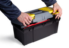 Time To Fix Something. Hands opening chest with tools over white background Stock Images