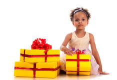 Time to give presents! Young girl with curly hair and yellow gift box on white background Stock Photos