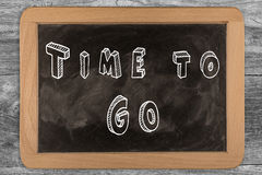 Time to Go - chalkboard with outlined text. On wood Stock Photos