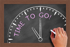 Time to Go. Concept drawn on blackboard with chalk in hand Royalty Free Stock Photos