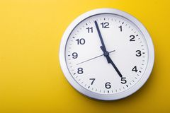 Time to go home. The clock is almost five Royalty Free Stock Photos
