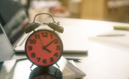 Time to go home. The alarm clock counting Royalty Free Stock Photography