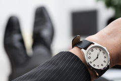 Time to go home. Relaxed businessman waiting to the end of work stock images