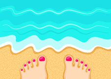 Time to go swimming. Female feet on the sand in front of the sea waves. Rest at the beach. Leisure and relaxation concept Stock Image