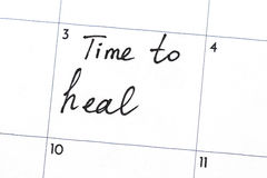 `time to heal` text write on calendar Royalty Free Stock Image