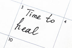 `time to heal` text write on calendar.  stock photos