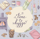 Time to Hygge. Cozy home things. Handdrawn card. Greeting card template with illustrations cozy home things like candles, socks, tea, fireplace and cookies, hand Royalty Free Stock Photo