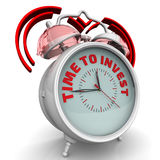 Time to invest. The alarm clock with an inscription Stock Images