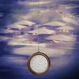 Time to Invest concept. Modern clock hanging on chain on blurred Royalty Free Stock Photos