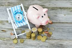 Time to invest your savings concept with pile of money , alarm clock and piggy bank royalty free stock photos