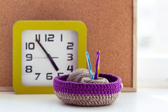 Time to knit. Knitted baskets crochet note board Stock Image
