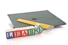 Time to Learn. Graduation Cap With Pencils And Learn Stock Image