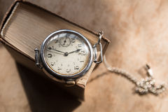 Time to Learn concept. Time to Learn concept, retro wristwatch on a book Stock Image