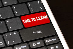 Time to learn on Red Enter Button on black keyboard Royalty Free Stock Image