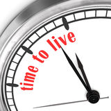 Time To Live. A clock with the text time to live on the white wall Stock Image