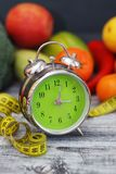 Time to lose Weight. Fruit, Vegetable and Alarm Clock on the table, Diet and Fitness concept. Time to lose Weight. Fruit, Vegetable and Alarm Clock on the table Royalty Free Stock Photos
