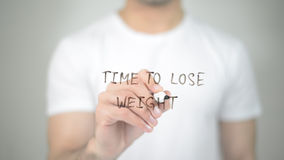Time to Lose Weight, man writing on transparent screen. High quality Royalty Free Stock Images