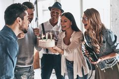 Time to make a wish! Happy young man blowing candles while celeb stock images