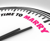Time to Marry - Clock for Wedding Ceremony. White clock with words Time to Marry on its face, symbolizing the date of a marriage ceremony and celebration Stock Image