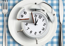 Time to meal concept, cut clock on plate. top view. Time to meal concept, cut clock on plate stock photography