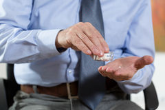 Time to a medication for elderly man Royalty Free Stock Image