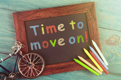 Time to move on - written with crayons on the chalkboard Royalty Free Stock Photos